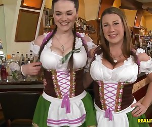 Provocative turned on brunette lezzies Katerine and Tessa Lane with with hot bodies and massive knockers in sexy uniform seduce famous pornstar Voodoo and start having threesome.