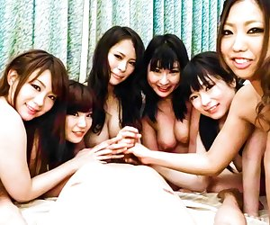 Five Japanese young girls entertain each other. They lick big Tits and caress her friend with different toys. Then the guy comes and they suck him off and RUB against him with Tits.