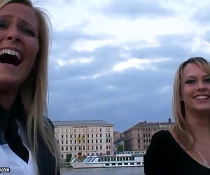 These two hot golden hared girls Blue Angel and Sophie Moone are pretty excited to see the city from a boat, while riding and teasing in front of the camera that records them.