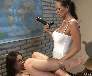 Hot and evil mistress Mandy Bright is punishing her sexy slave Bambi for her bad behavior, she is doing some crazy and naughty things to her slave while reading a book and using a dildo.