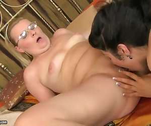 Experienced mature blonde Madeline with natural tits and big juicy ass has awesome licking and fingering session with young slender black haired babe Patricia Dream all over bedroom.